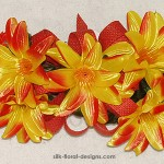 spring twig swag with yellow-orange lilies and small orange daisies